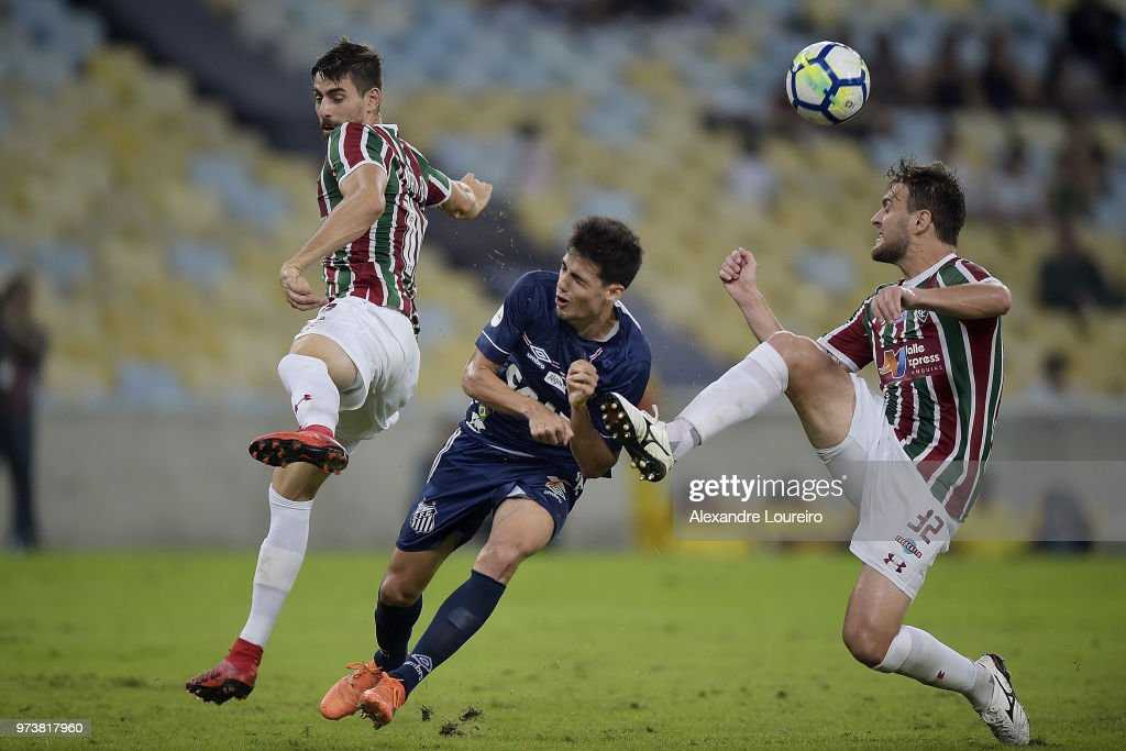 Roger Ibañez (L) of Fluminense and Nathan Ribeiro struggles for the ball with Léo Cittadini of Santos during the match between Fluminense and Santos as part of Brasileirao Series A 2018 at Maracana Stadium on June 13, 2018 in Rio de Janeiro, Brazil.