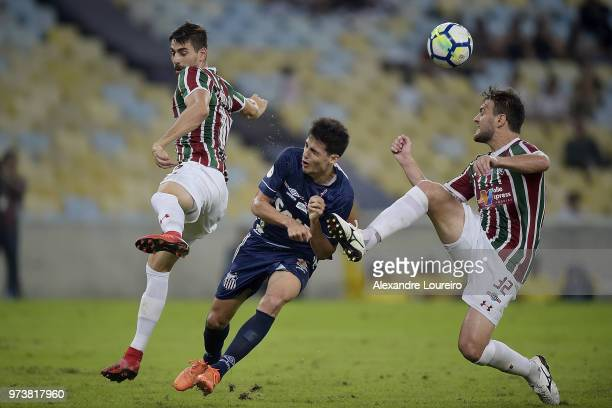 Roger Ibañez of Fluminense and Nathan Ribeiro struggles for the ball with Léo Cittadini of Santos during the match between Fluminense and Santos as...