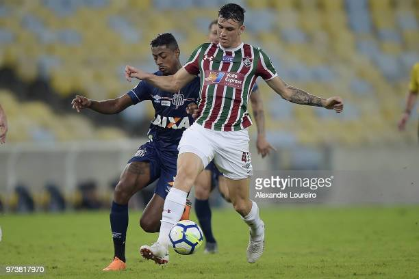 Roger Ibañez of Fluminense struggles for the ball with Bruno Henrique of Santos during the match between Fluminense and Santos as part of...