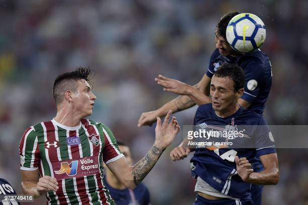 Roger Ibañez of Fluminense struggles for the ball with Gustavo Henrique and Diego Pituca of Santos during the match between Fluminense and Santos as...