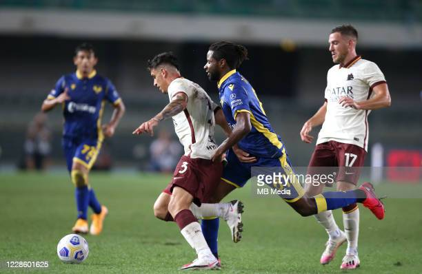 Roger Ibanez of As Roma competes for the ball with Adrien Tameze of Hellas Verona FC ,during the Serie A match between Hellas Verona FC and AS Roma...