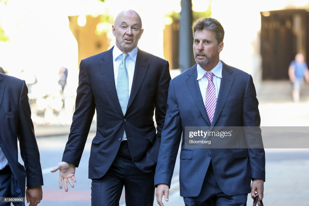 Roger Jenkins, former chairman of investment banking for the Middle East at Barclays Plc, centre, arrives at Southwark Crown Court in London, U.K., on Monday, July 17, 2017. Jenkins, along with three formerBarclays Plcexecutives will stand trial on allegations they conspired to commit fraud over the bank's 2008 fundraising with Qatar in 2019, a London judge ruled. Photographer: Chris Ratcliffe/Bloomberg via Getty Images