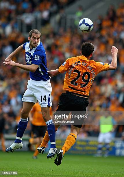 Roger Johnson of Birmingham City attempts to head past Jan Vennegoor of Hesselink of Hull City during the Barclays Premier League match between Hull...