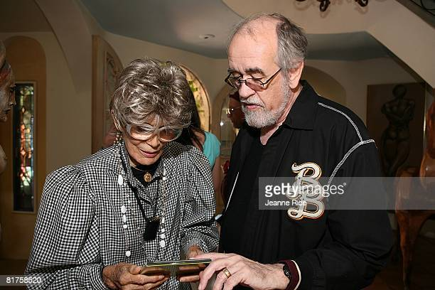 Roger Kellaway gives his album of the year CD to Maxine Kim StussyFrankel at theTrigg Ison Fine art exhibit for the work of Maxine Kim StussyFrankel...