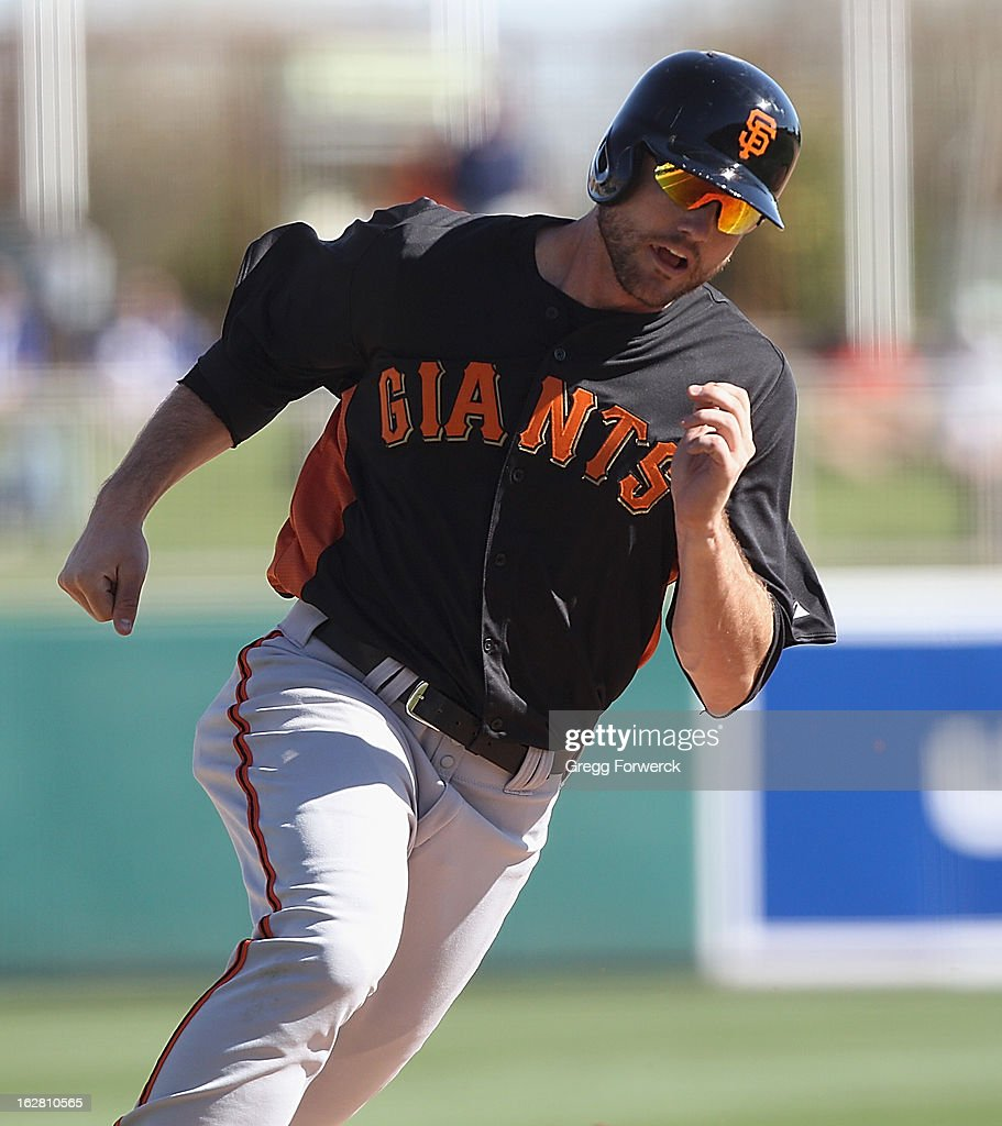 Roger Kieschnick of the San Francisco Giants runs on a base hit during a spring training baseball game against the Los angeles Dodgers at Camelback Ranch on February 26, 2013 in Glendale, Arizona.