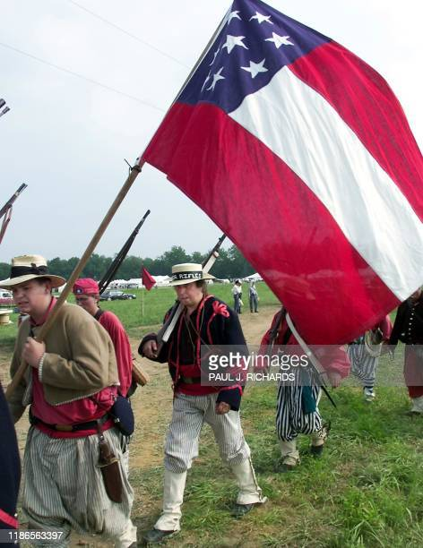 Roger Kirwin formerly of Liverpool England and currently living in Harrisburg PA marches under an early Confederate battle flag with the 1st...