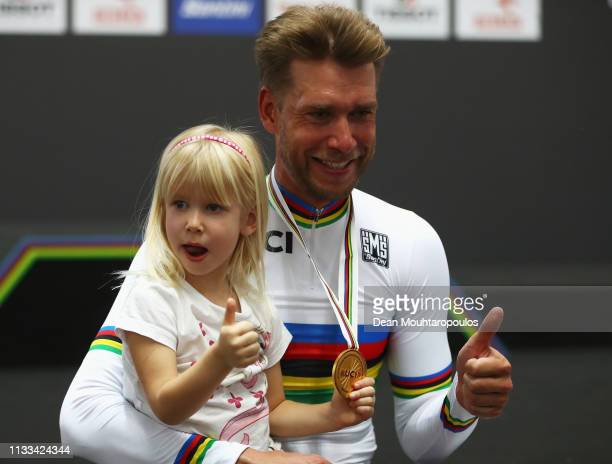 Roger Kluge of Germany celebrates winning the gold medal with his daughter in the Men's Madison on day five of the UCI Track Cycling World...
