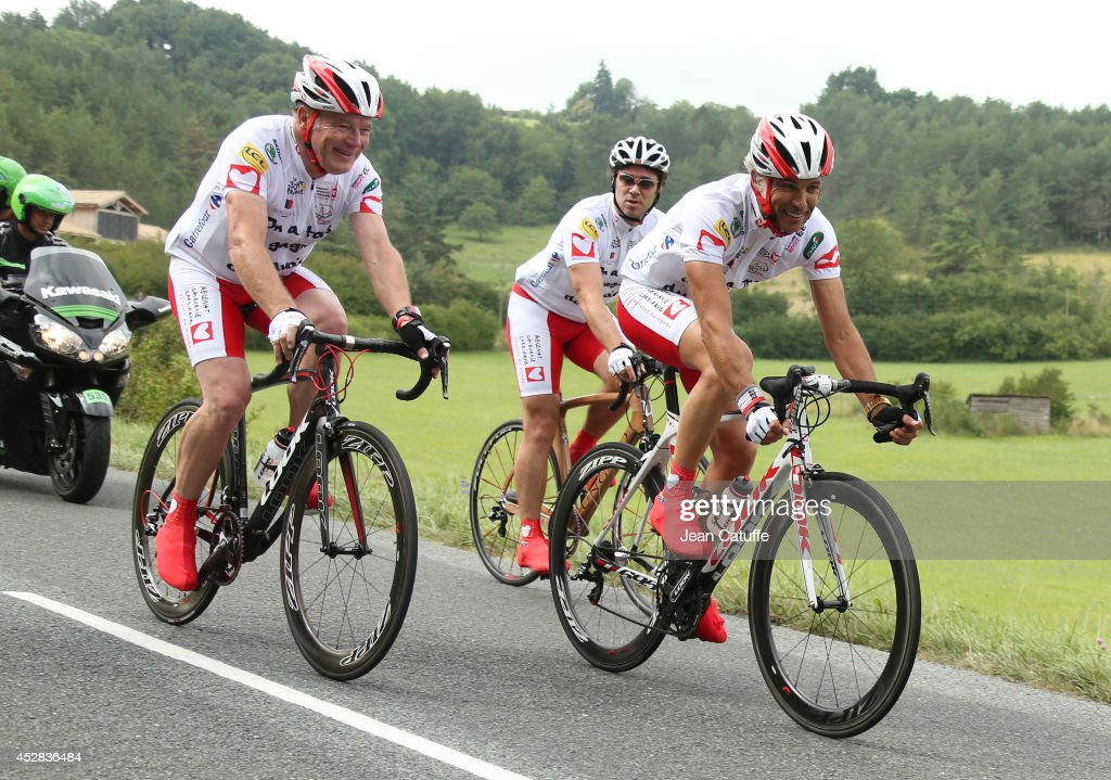 Roger Legeay and Paul Belmondo participate at 'l'etape du coeur' to benefit the foundation 'Mecenat Chirurgie Cardiaque', riding couple hours before the professionals stage twenty of the 2014 Tour de France, a 54 km individual time trial stage between Bergerac and Perigueux on July 26, 2014 in Perigueux, France.