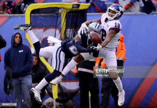 Roger Lewis of the New York Giants fights for a pass against Jourdan Lewis of the Dallas Cowboys in the third quarter during their game at MetLife...