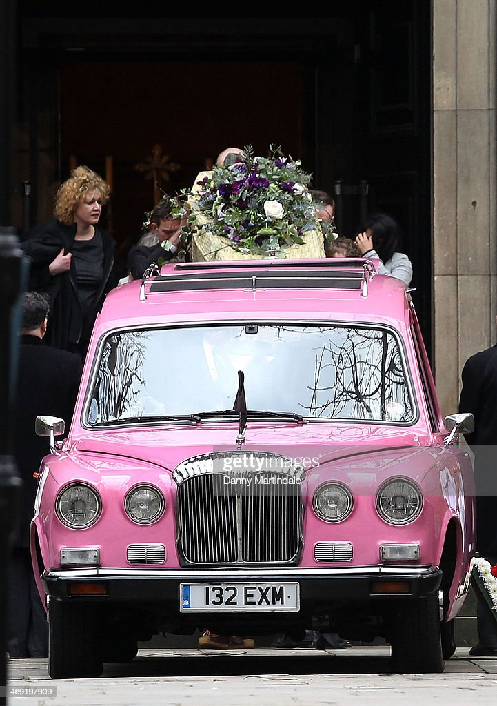 Roger Lloyd-Pack's coffin is placed back into the pink hearse at the end of the funeral of actor Roger Lloyd-Pack at St Paul's Church on February 13, 2014 in London, England.