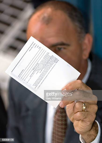Roger Maier of the US Department of Homeland Security USVISIT Program displays a new visa card August 11 2005 in Nogales Arizona The new card has an...