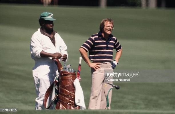 Roger Maltbie looks down the fairway from the tee box with his caddie during the 1977 Masters Tournament at Augusta National Golf Club on April 1977...