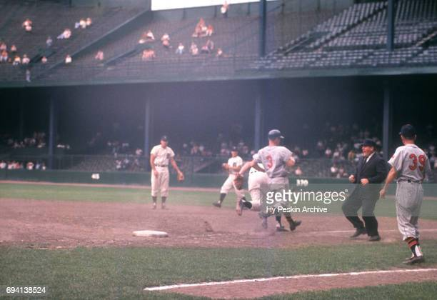 Roger Maris of the Kansas City Athletics is called out by first base umpire John Rice as he was beaten to the bag by pitcher Tom Morgan of the...