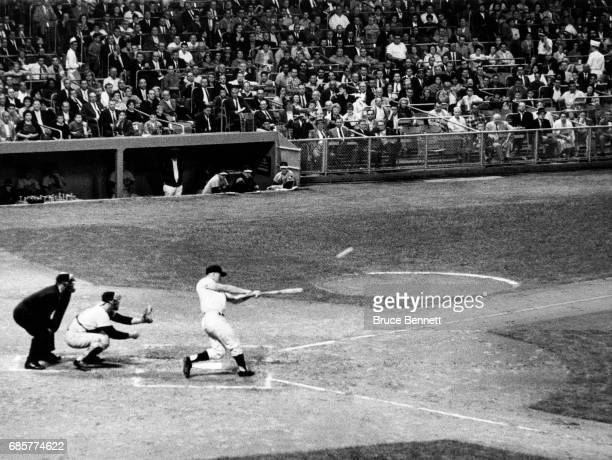 Roger Maris of the New York Yankees hits the ball for his 60th homerun of the year to tie Babe Ruth's homerun record against pitcher Jack Fisher of...