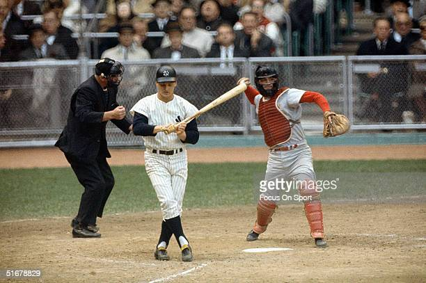 Roger Maris of the New York Yankees strikes out during the1964 world series against the St Louis Cardinals at Yankee Stadium in Bronx New York