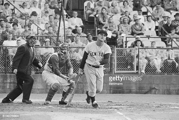 Roger Maris of the New York Yankees watches his first homer of spring training exhibition games go over the right field fence in first inning of game...