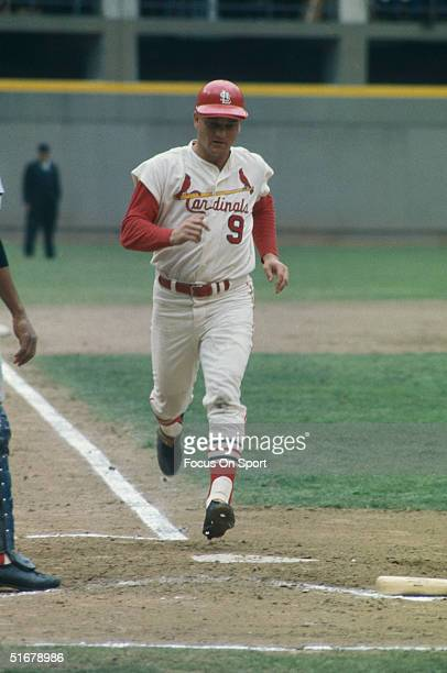 Roger Maris outfielder for the St Louis Cardinals crossing home plate at Busch Stadium during the World Series playing against the Boston Red Sox at...