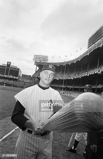 Roger Maris, wielding the big bat that accounted for 61 home runs in 1961, prepares for the opening game of the World Series at batting practice in...