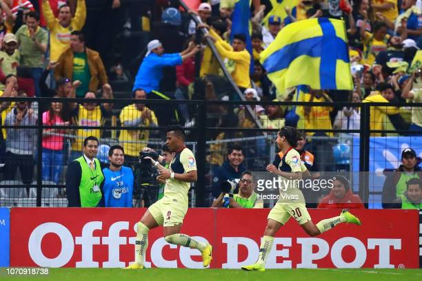 Roger Martinez of America celebrates with teammate after scoring the third goal of his team during the semifinal second leg match between America and...