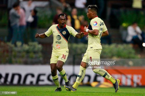 Roger Martinez of America celebrates with teammate Renato Ibarra after scoring the fourth goal of his team during the match between America and...