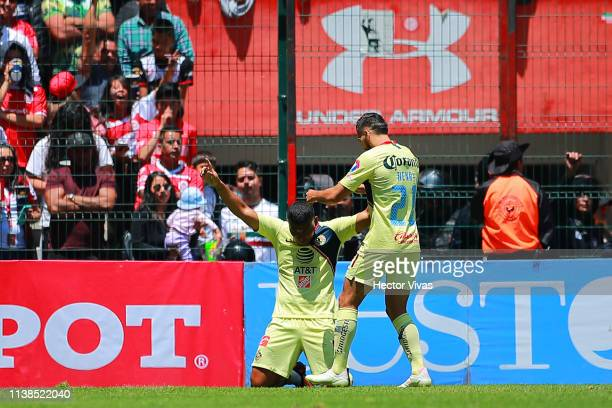 Roger Martinez of America celebrates with teammates after scoring the first goal of his team during the 15th round match between Toluca and America...