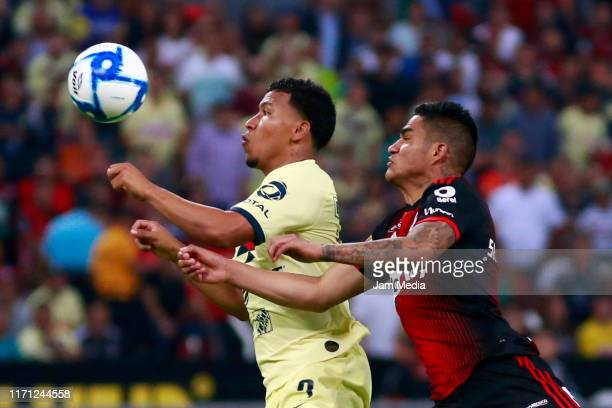 Roger Martinez of America fights for the ball with Anderson Santamaria of Atlas during the 8th round match between Atlas and America as part of the...