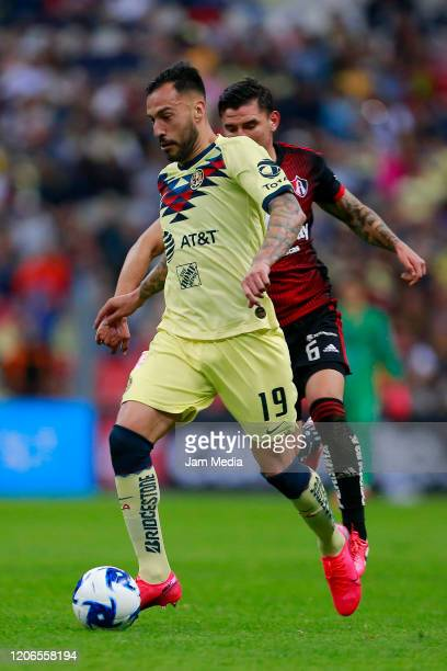 Roger Martinez of America fights for the ball with Christopher Trejo of Atlas during the 6th round match between America and Atlas as part of the...