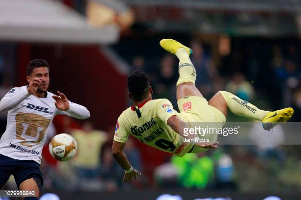 Roger Martinez of America scores the third goal of his team during the semifinal second leg match between America and Pumas UNAM as part of the...