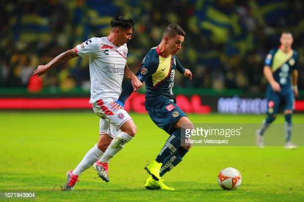 Roger Martinez of America struggle for the ball against Joe Abrigo of Veracruz during the 17th round match between America vs Veracruz as part of the...