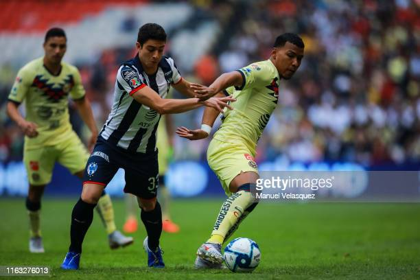 Roger Martinez of America struggle for the ball against John Medina of Monterrey during the 1st round match between America and Monterrey as part of...