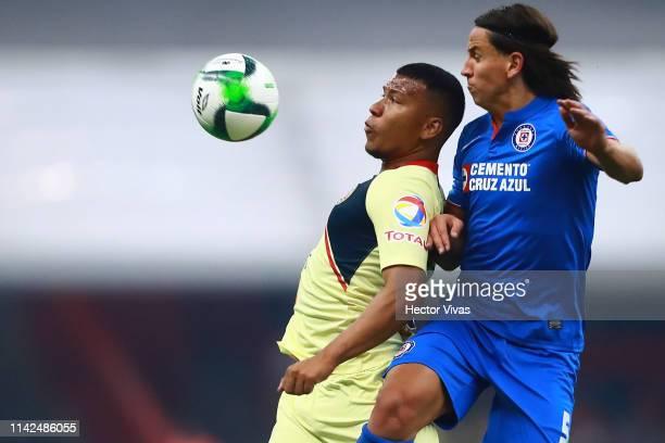 Roger Martinez of America struggles for the ball with Igor Lichnovsky of Cruz Azul during the quarterfinals first leg match between America and Cruz...