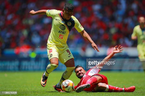 Roger Martinez of America struggles for the ball with Pedro Canelo of Toluca during the 15th round match between Toluca and America as part of the...