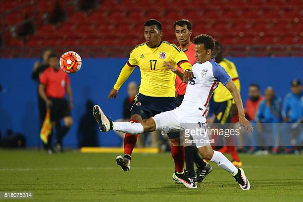 Roger Martinez of Colombia battles for possession with Desevio Payne of the US Under23 Men's National Team during the first half of the 2016 CONCACAF...