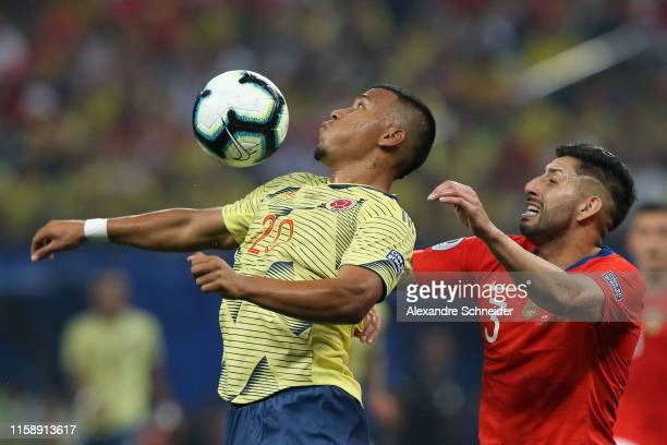 Roger Martinez of Colombia chests the ball against Guillermo Maripan of Chile during the Copa America Brazil 2019 quarterfinal match between Colombia...