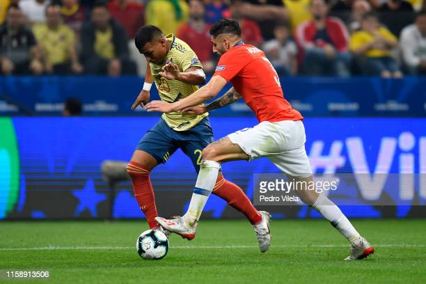 Roger Martinez of Colombia fights for the ball with Guillermo Maripan of Chile during the Copa America Brazil 2019 quarterfinal match between...