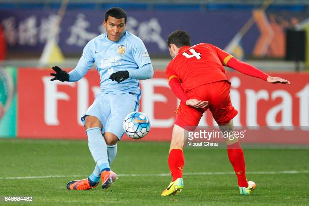 Roger Martinez of Jiangsu Suning and Dylan McGowan of Adelaide United compete for the ball during the AFC Champions League 2017 Group H match between...