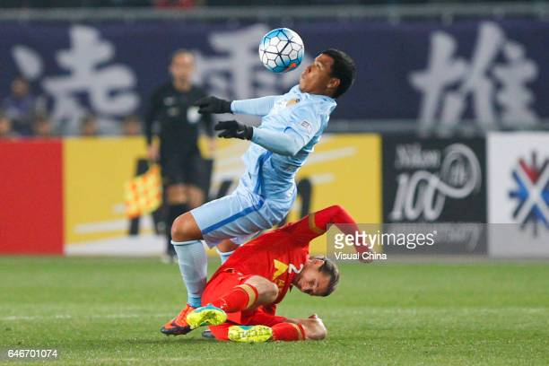 Roger Martinez of Jiangsu Suning and Michael Marrone of Adelaide United compete for the ball during the AFC Champions League 2017 Group H match...