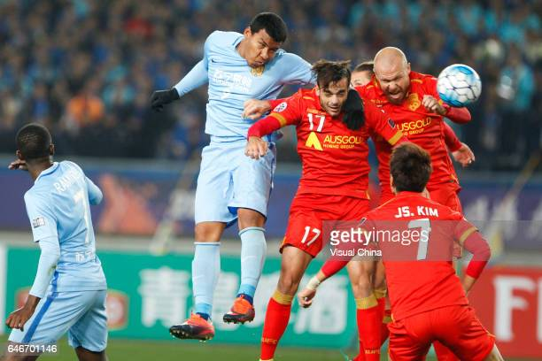 Roger Martinez of Jiangsu Suning and Nikola Mileusnic of Adelaide United compete for the ball during the AFC Champions League 2017 Group H match...