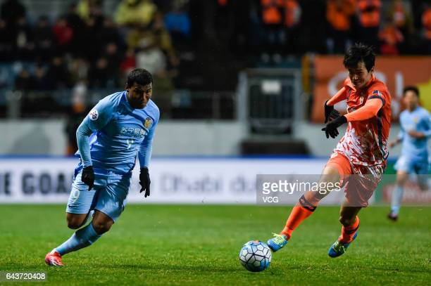 Roger Martinez of Jiangsu Suning and Oh Bansuk of Jeju United vie for the ball during 2017 AFC Asian Champions League group match between Jeju United...