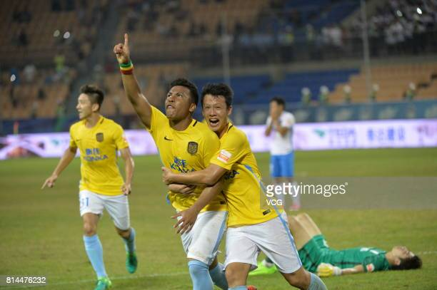 Roger Martinez of Jiangsu Suning celebrates with team mate after scoring his team's first goal during 2017 Chinese Super League 17th round match...