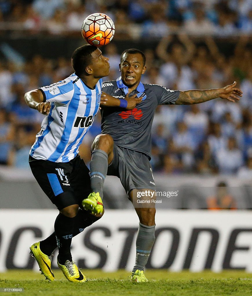 Roger Martinez of Racing Club fights for the ball with Edemir Rodriguez of Bolivar during a group stage match between Racing Club and Bolivar as part of Copa Bridgestone Libertadores 2016 at Presidente Peron Stadium on February 24, 2016 in Avellaneda, Argentina.