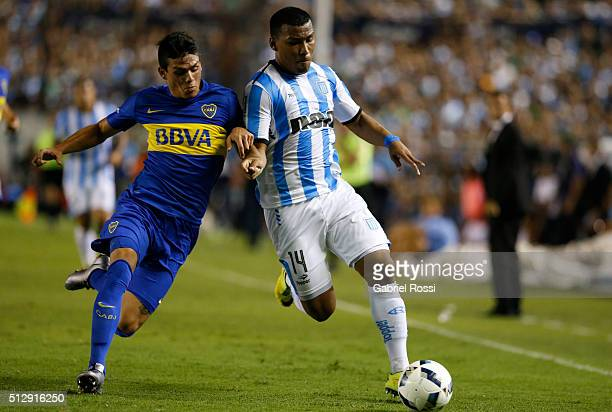Roger Martinez of Racing Club fights for the ball with Jonathan Silva of Boca Juniors during a fifth round match between Racing Club and Boca Juniors...