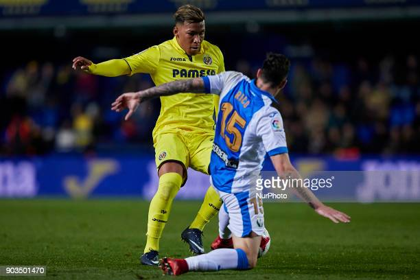 Roger Martinez of Villarreal CF competes for the ball with Diego Rico of CD Leganes during the Copa del Rey Round of 16 second leg game between...