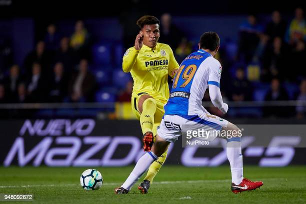 Roger Martinez of Villarreal CF competes for the ball with Munoz of CD Leganes during the La Liga game between Villarreal CF and Club Deportivo...