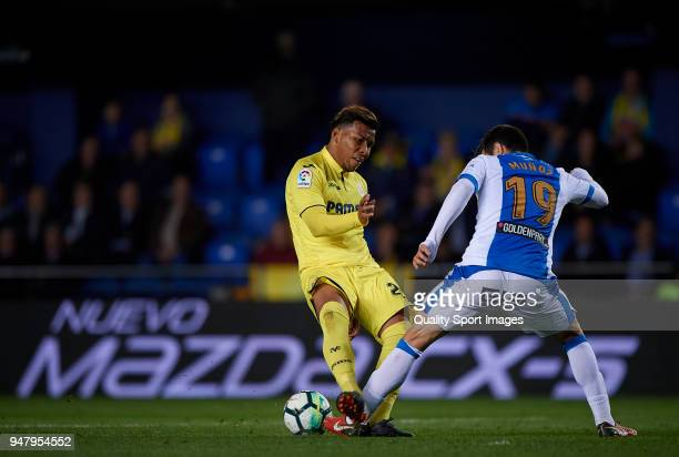 Roger Martinez of Villarreal competes for the ball with Ezequiel Munoz of Leganes during the La Liga match between Villarreal and Leganes at Estadio...