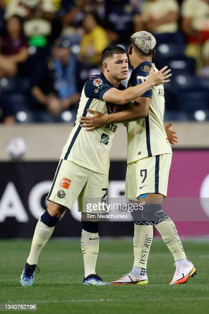 Roger Martínez and Leonardo Suárez of Club America embrace before playing against Philadelphia Union during the semifinal second leg match of the...