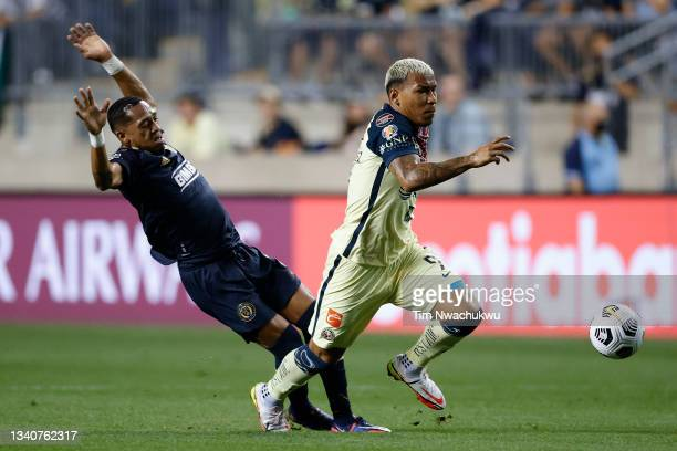 Roger Martínez of Club America dribbles past José Martínez of Philadelphia Union during the semifinal second leg match of the CONCACAF Champions...