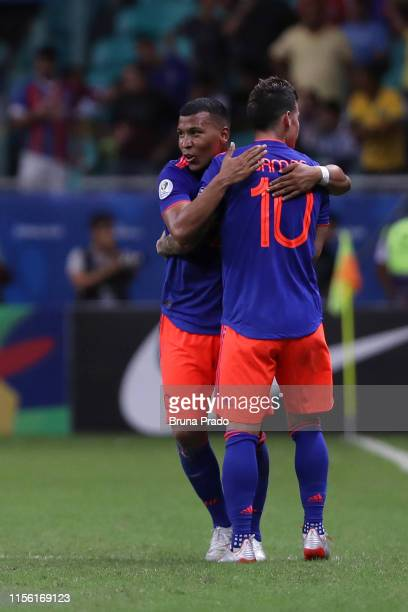 Roger Martínez of Colombia celebrates with teammate James Rodriguez after scoring the first goal of his team during the Copa America Brazil 2019...