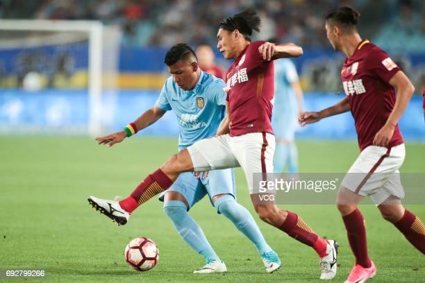 Roger Martnez of Jiangsu Suning and Zhang Chengdong of Hebei China Fortune FC compete for the ball during the 12th round match of 2017 Chinese...