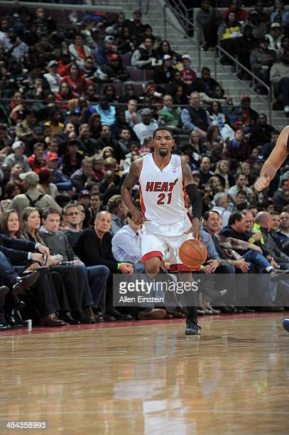 Roger Mason Jr #21 of the Miami Heat dribbles up the floor against the Detroit Pistons during the game on December 8 2013 at The Palace of Auburn...